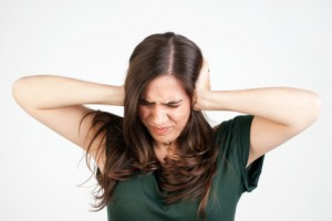 iStock Woman Blocking Noise